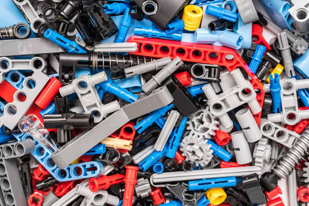 This is a close look at a  pile of lego technic pieces.