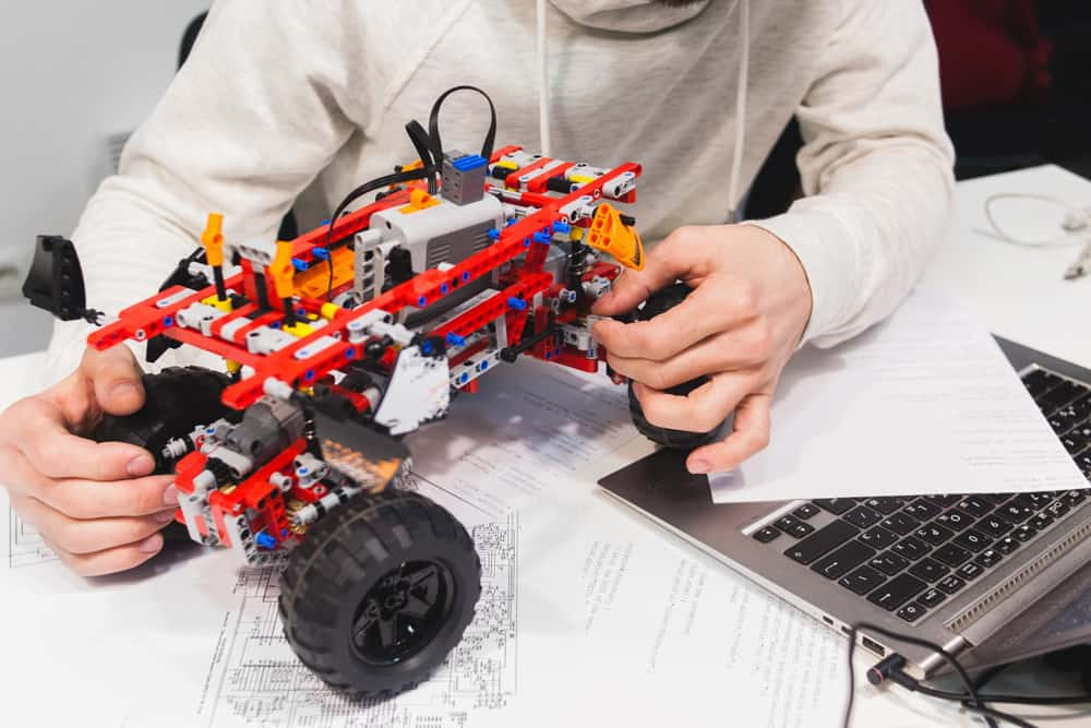 This is a close look at a  constructed toy truck made of lego pieces.