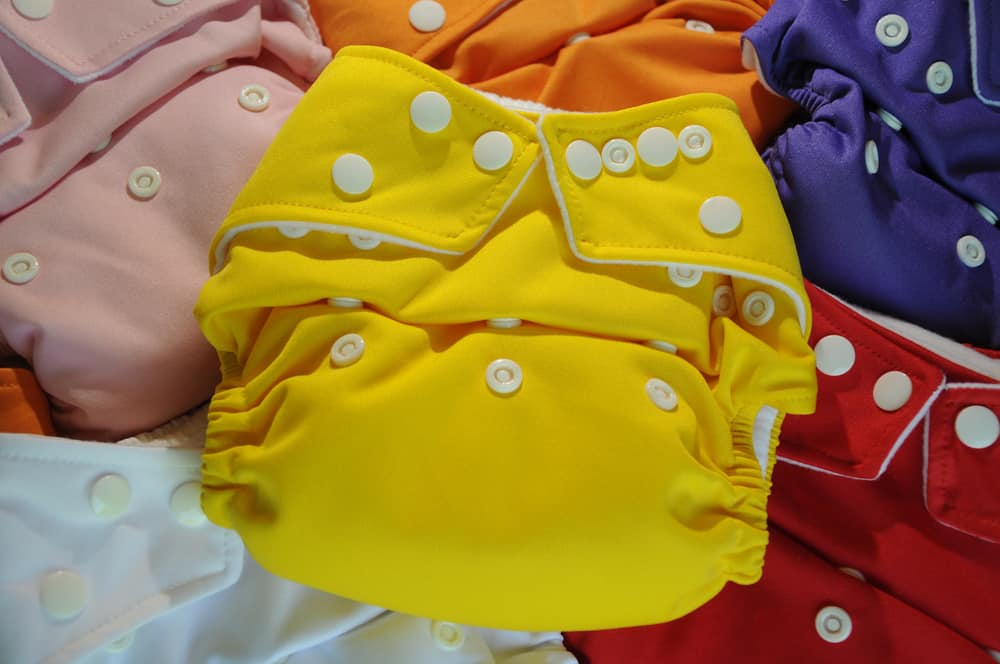 This is a close look at various colorful cloth diapers.