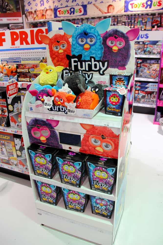 Various Furby toys on display at a toy store.