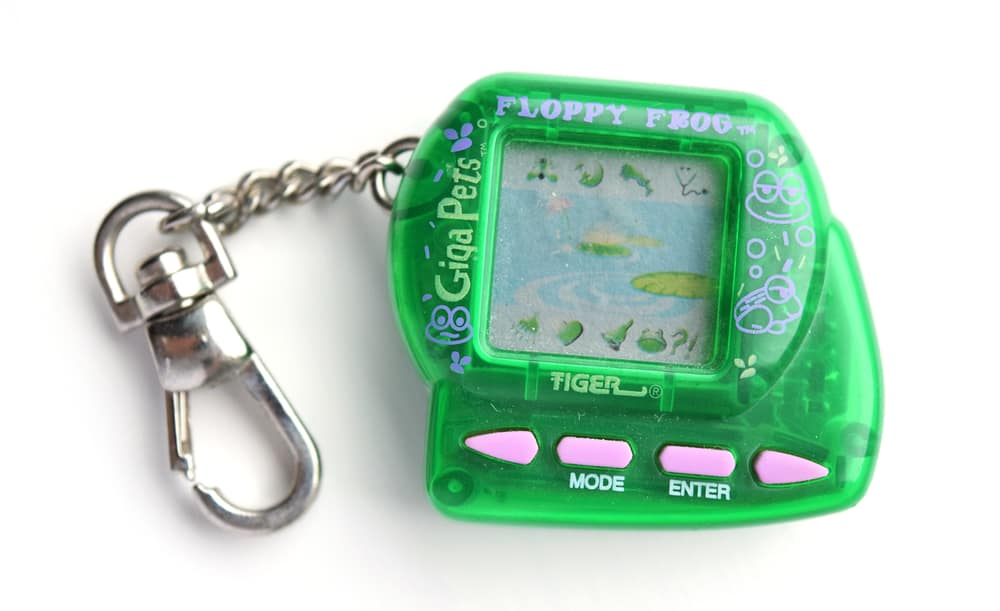 This is a close look at a Giga Pets Floppy Frog miniature game.