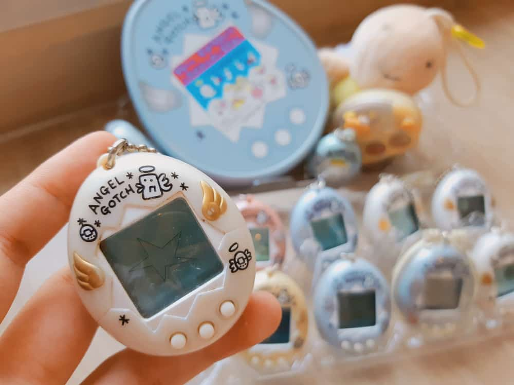 A close look at an Angel Tamagotchi on display at a toy store.