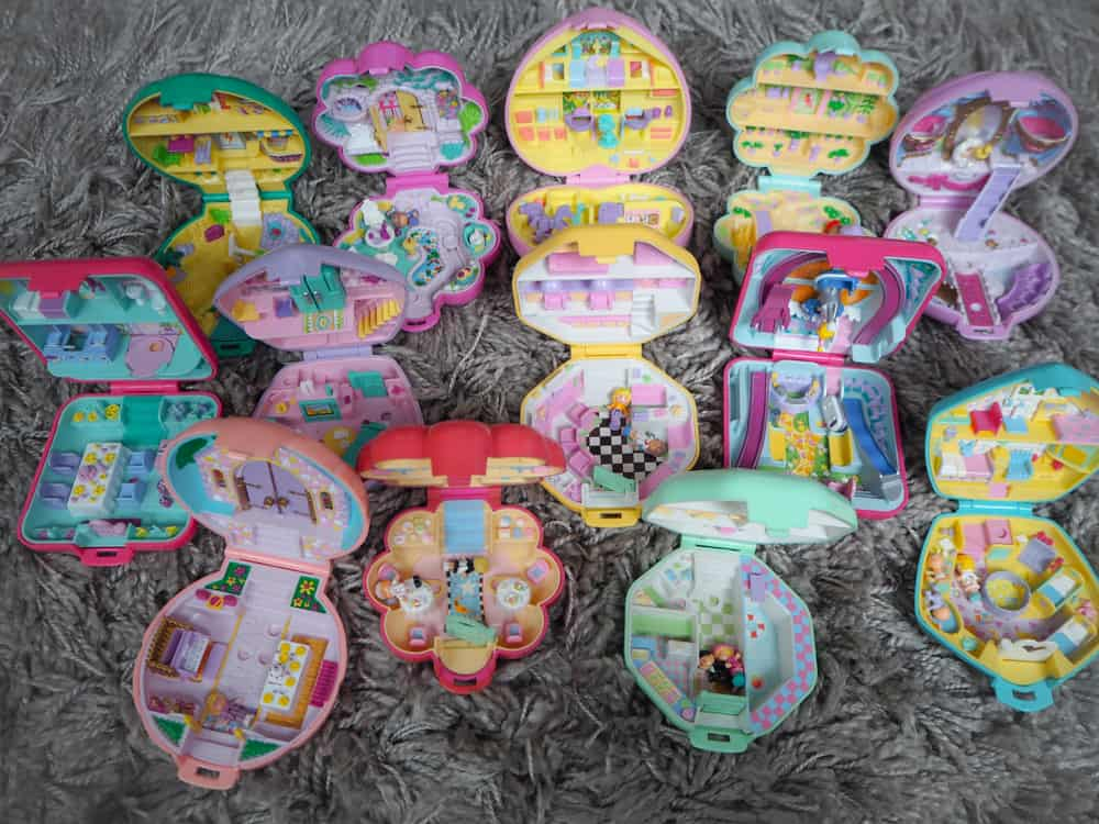 This is a close look at a collection of various colorful Polly Pockets.