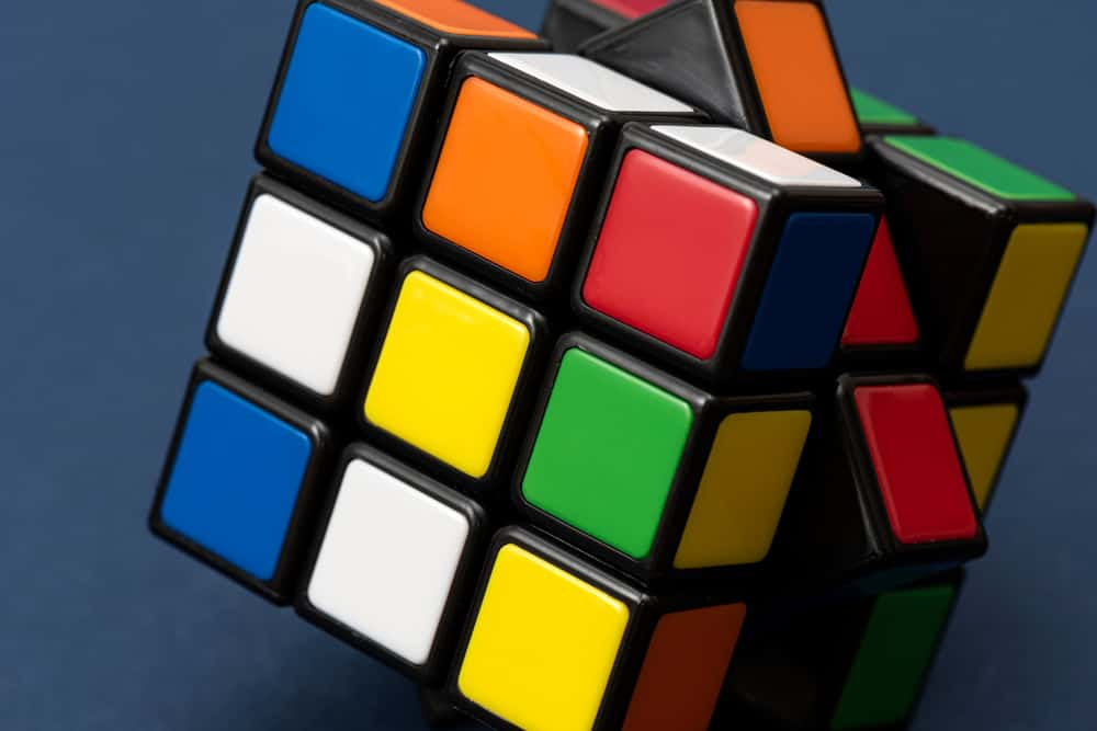 This is a close look at a Rubik's puzzle toy cube with colorful blocks.