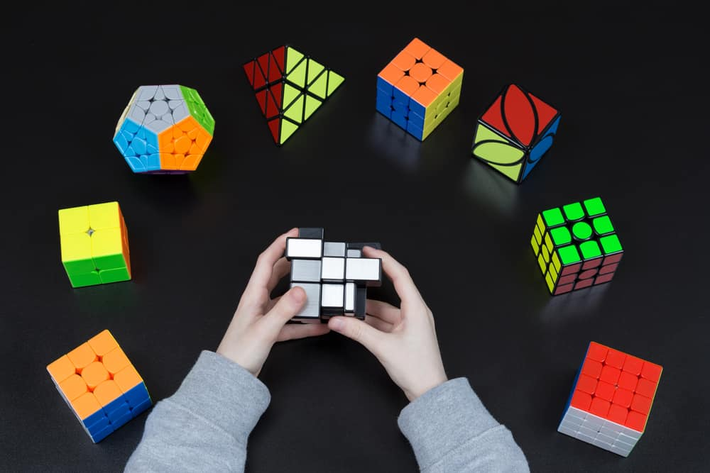 This is a close look at a collection of various Rubik's cube variations.