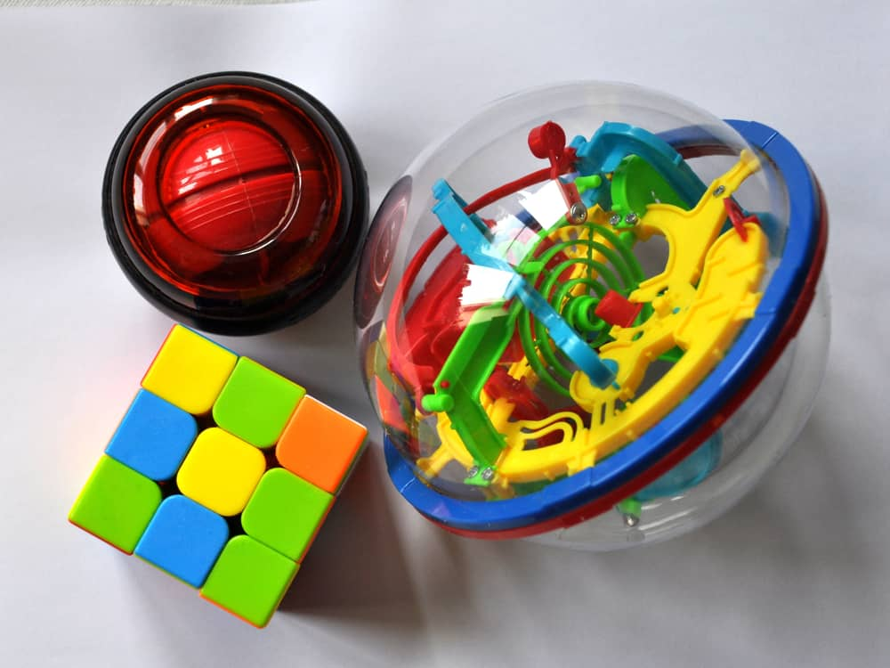 This is a close look at various toys like the Rubik's cube puzzle toy.