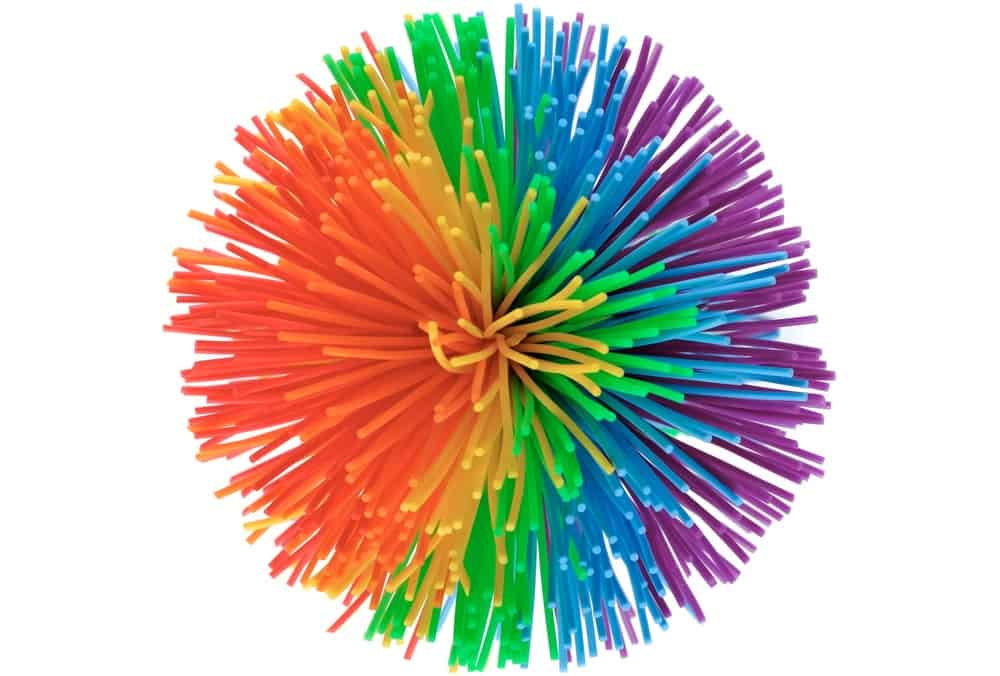 A close look at a koosh ball with colorful features.