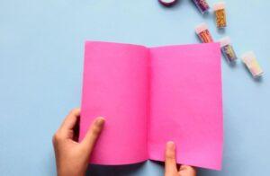 Fold pink paper in half