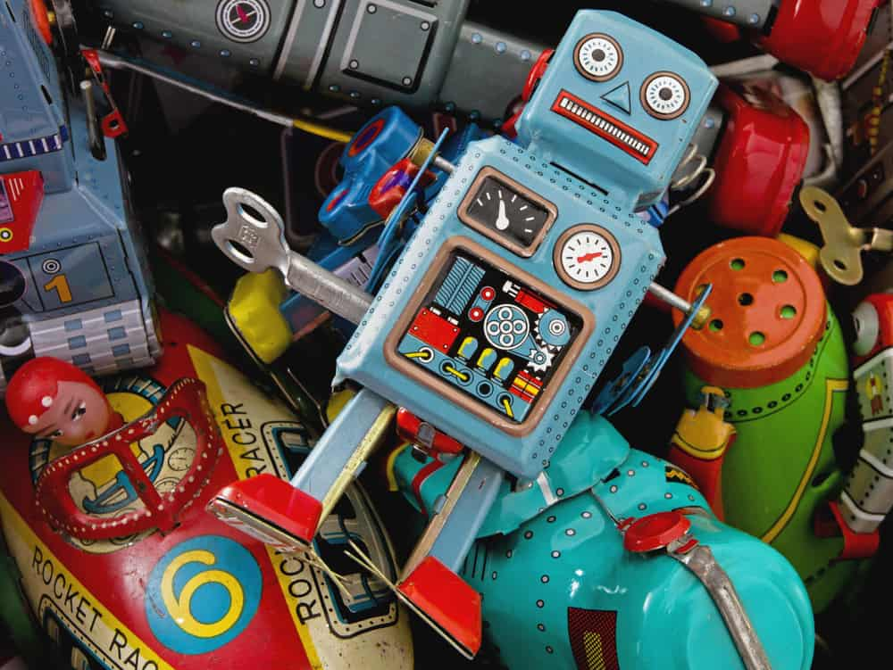 This is a close look at a bunch of toys made of tin.