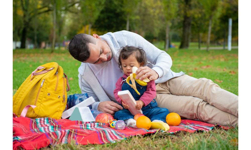 Baby and Dad on a Picnic.