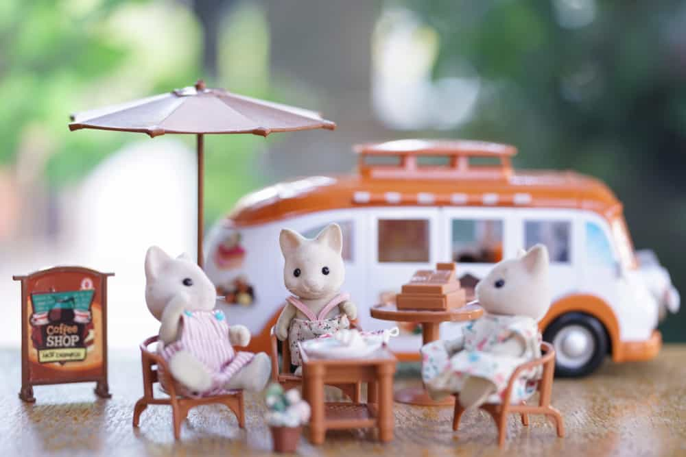 A group of Sylvanian cats chilling and having afternoon tea.