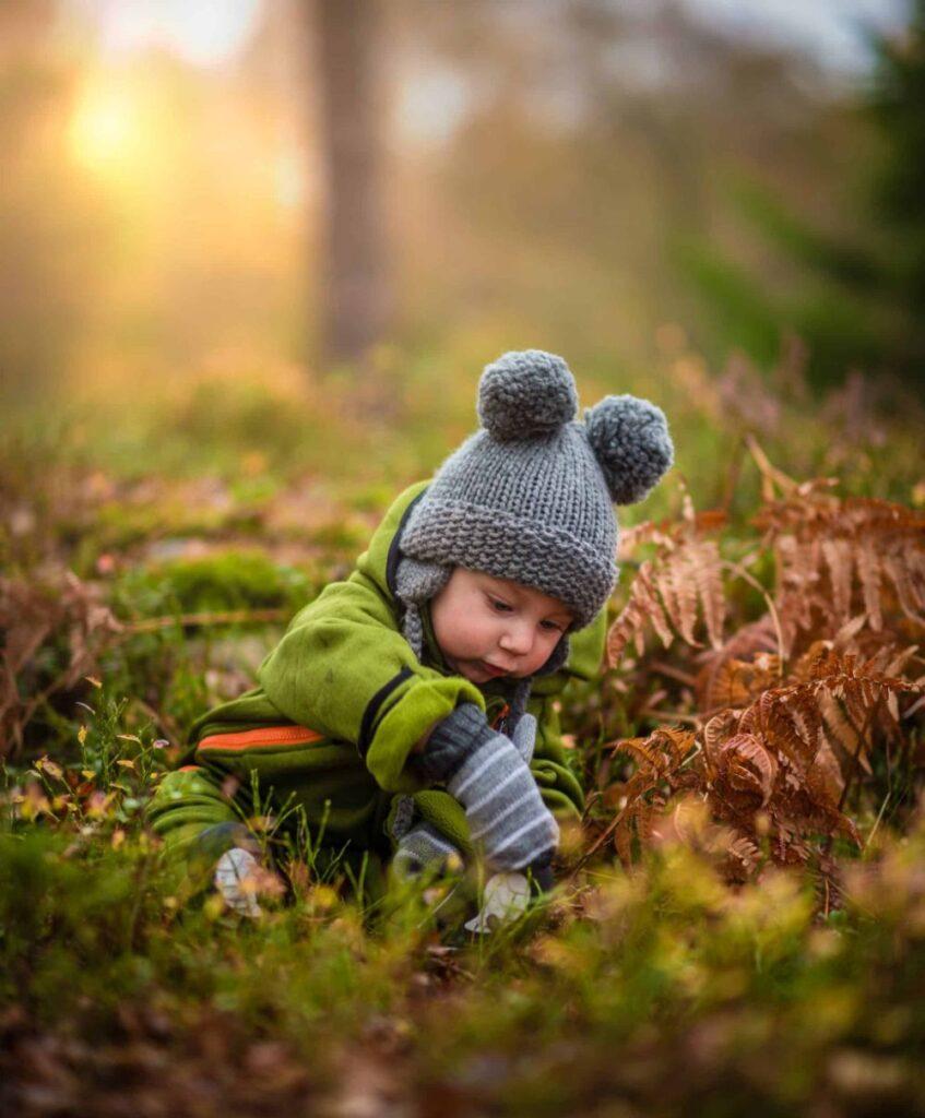 A baby in a garden.