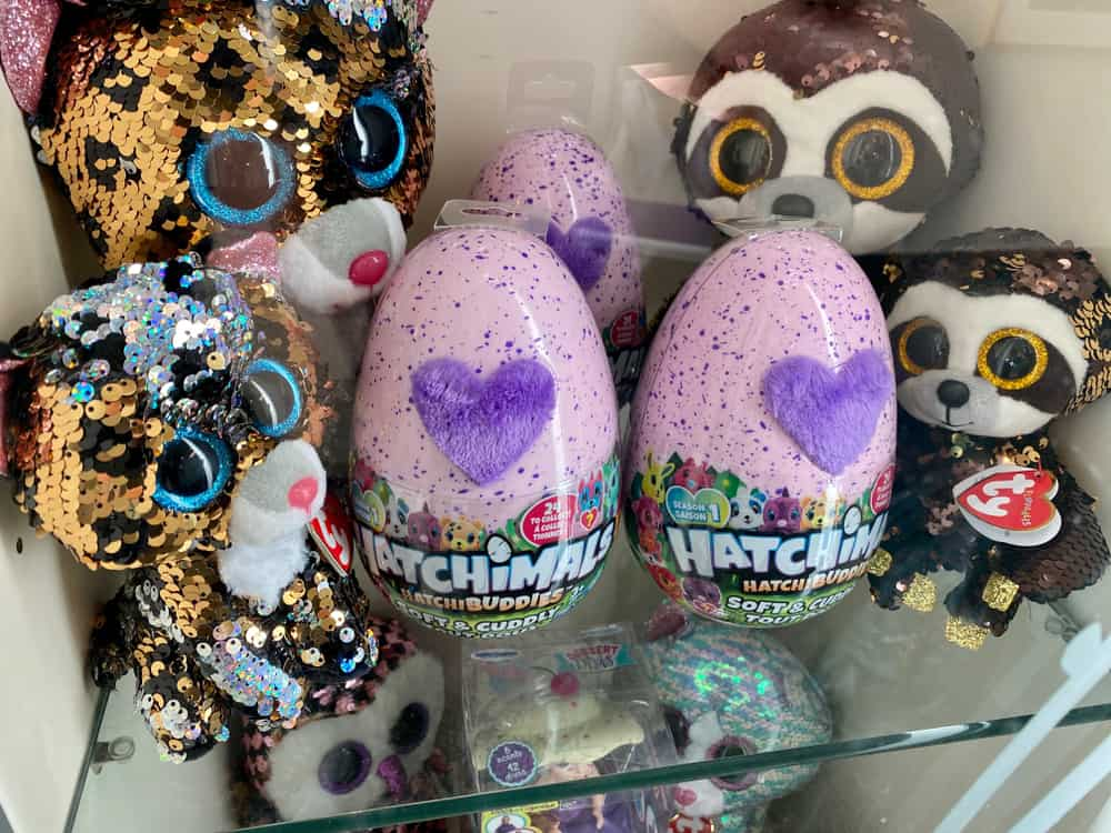 Hatchimals Hatch Buddies eggs on glass shelves.
