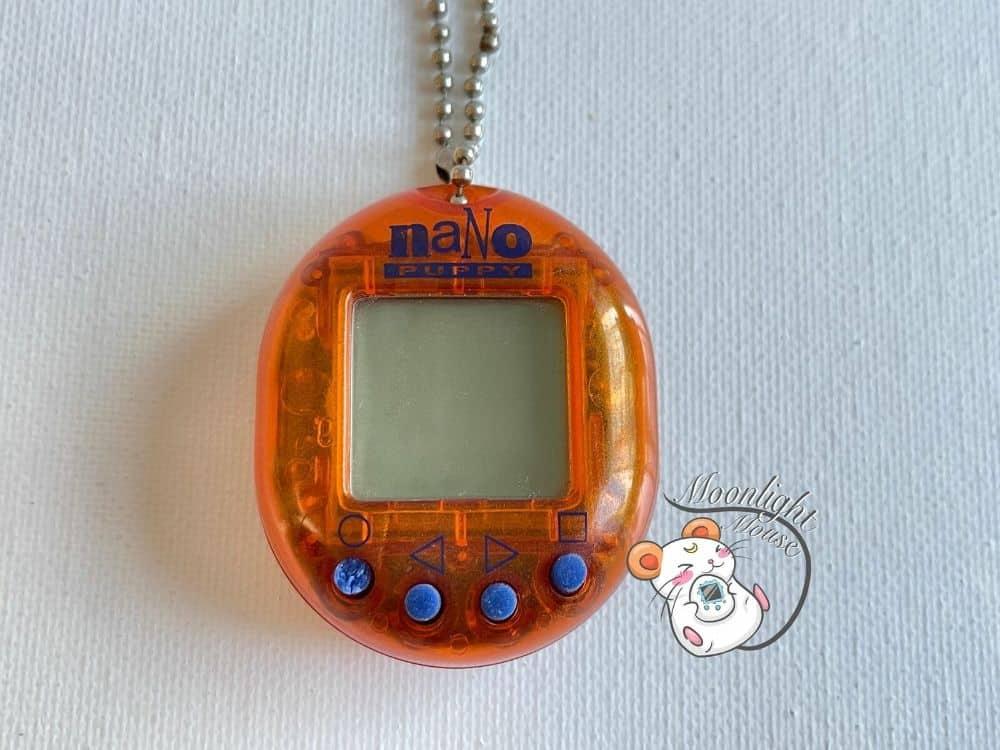 Nano Puppy Transparent Clear Orange Playmates Virtual Pet 1998