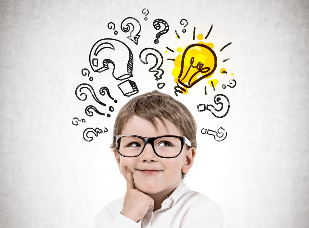 A kid with glasses that has ideas and questions in his head.