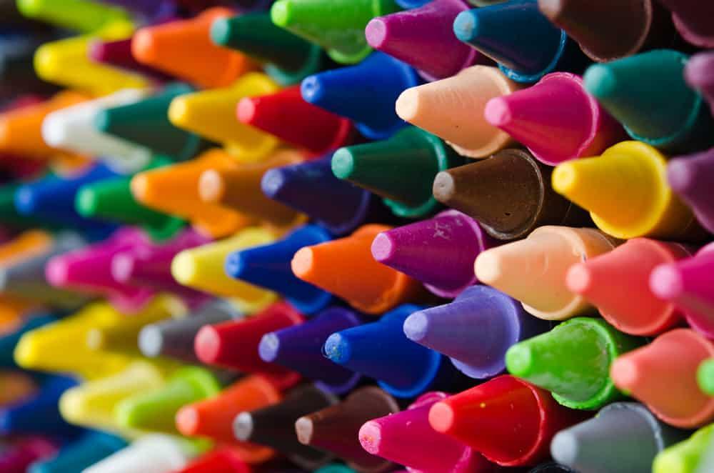 A close look at various colorful crayons.
