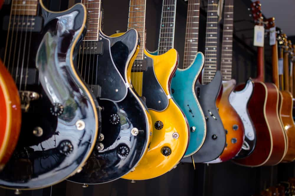 A look at various guitars on display at a store.