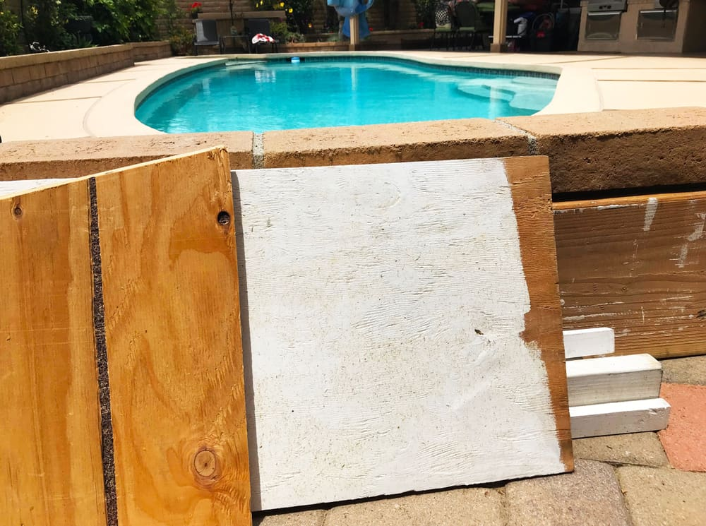 A couple of scrap boards placed beside the pool.