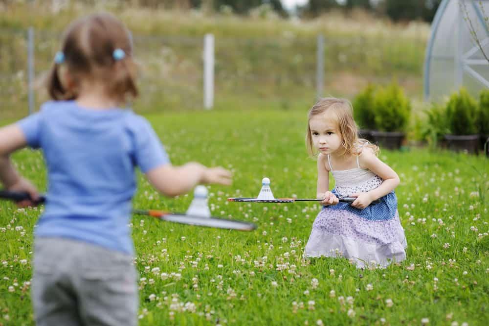 Two girls playing badminton.