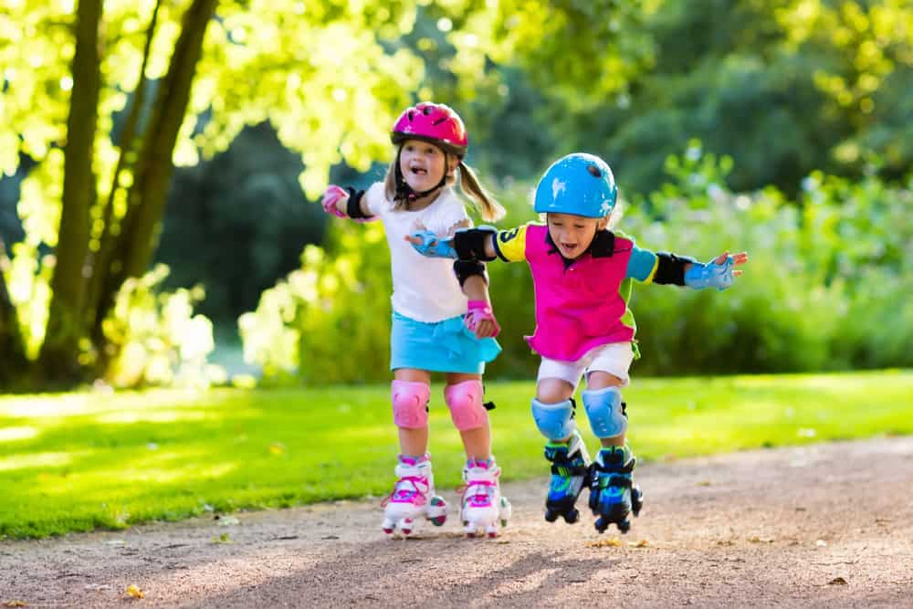A couple of girls roller skating.