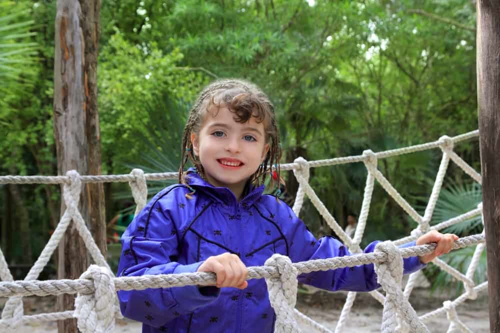 A girl on a rope bridge.