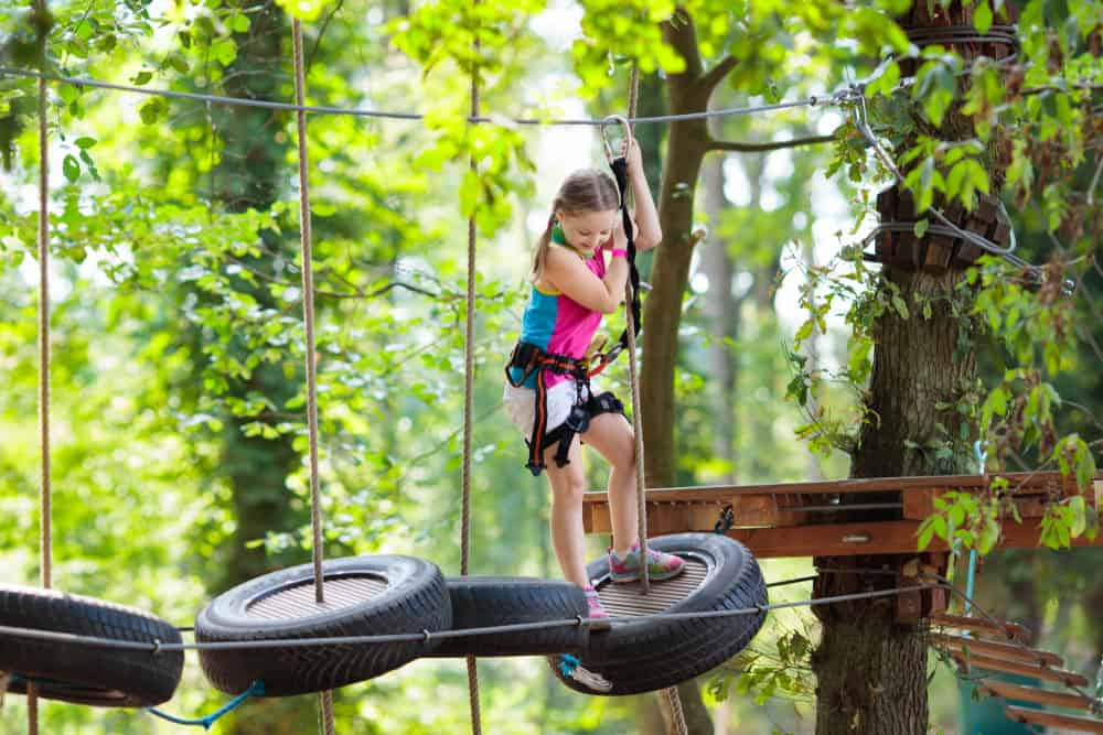 A girl on a rope course.
