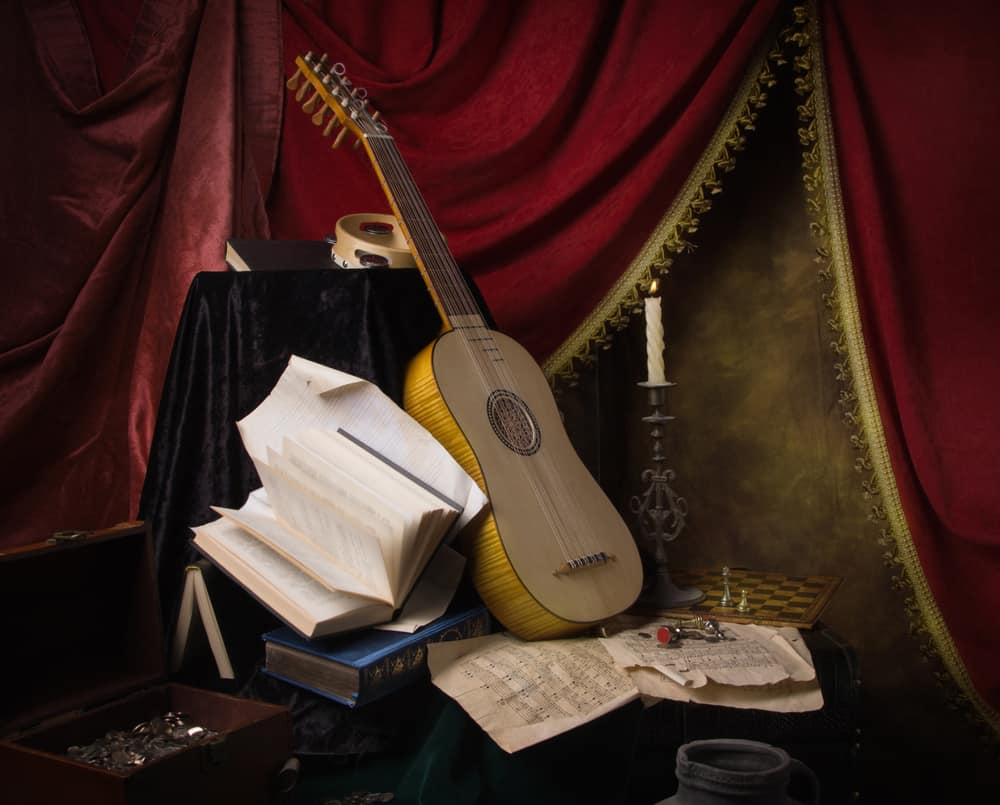 A Renaissance style guitar with music sheets.