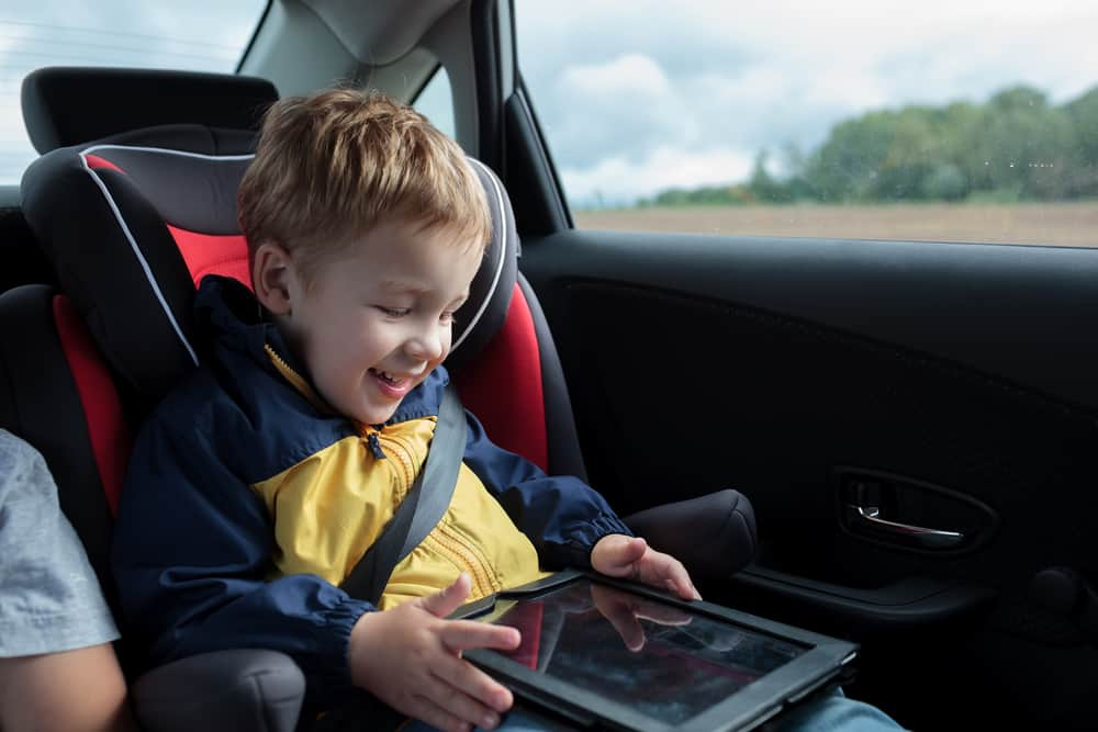 Kid reading a joke book in his tablet.