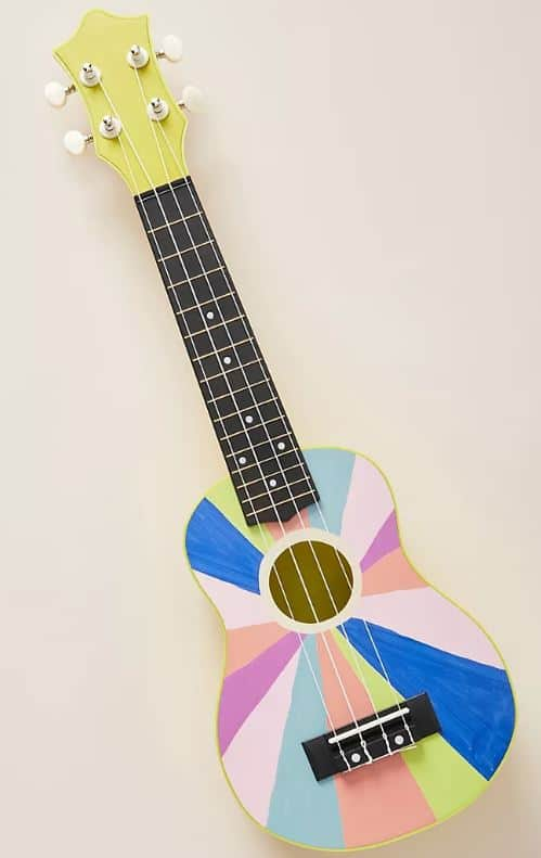 The wooden toy guitar from Anthropologie.