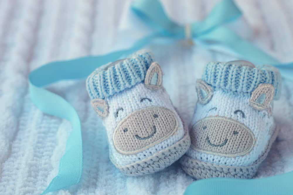 A pair of blue knitted baby shoes.