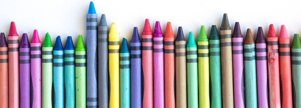 A row of various wax crayons.
