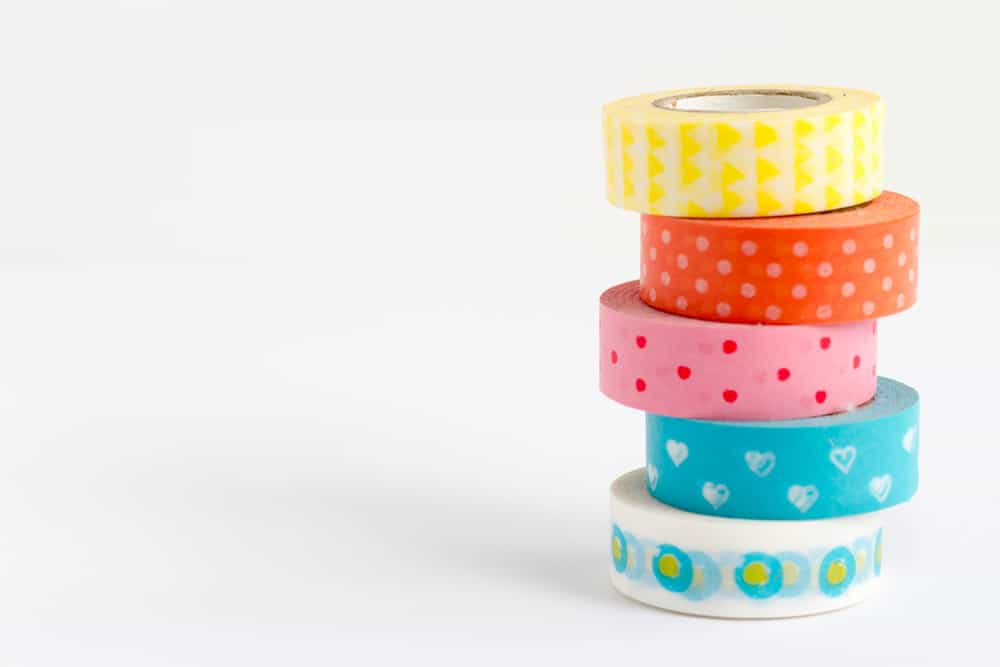 A stack of colorful patterned tapes.