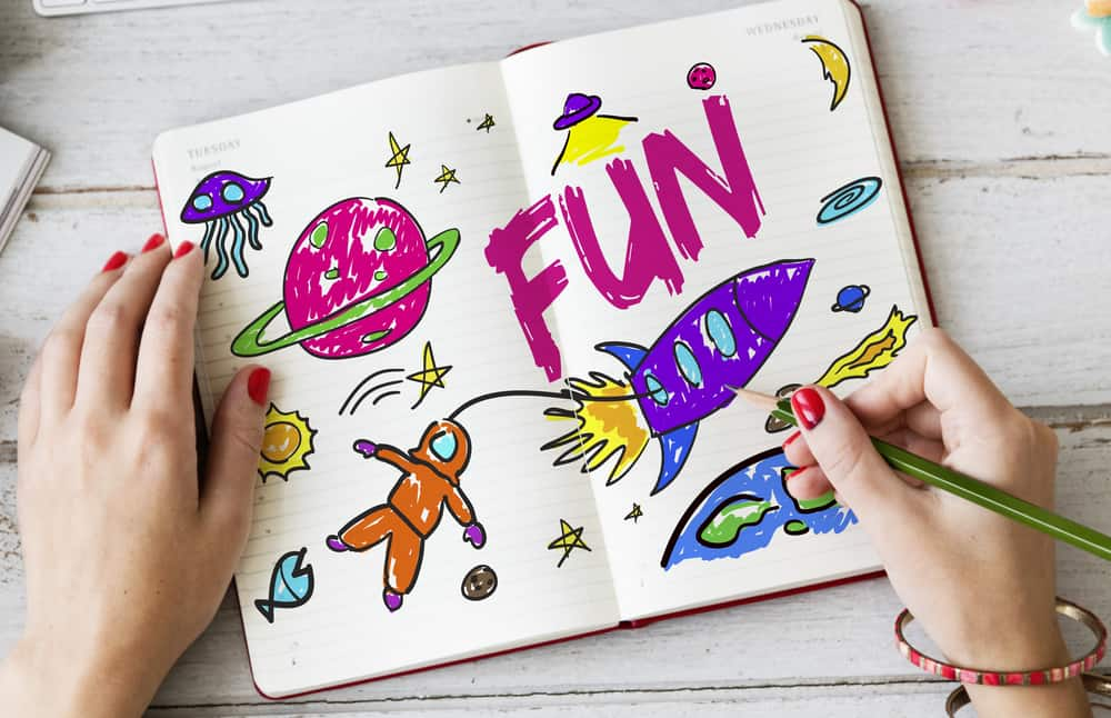 A close look at a colorful drawing of space in a journal.