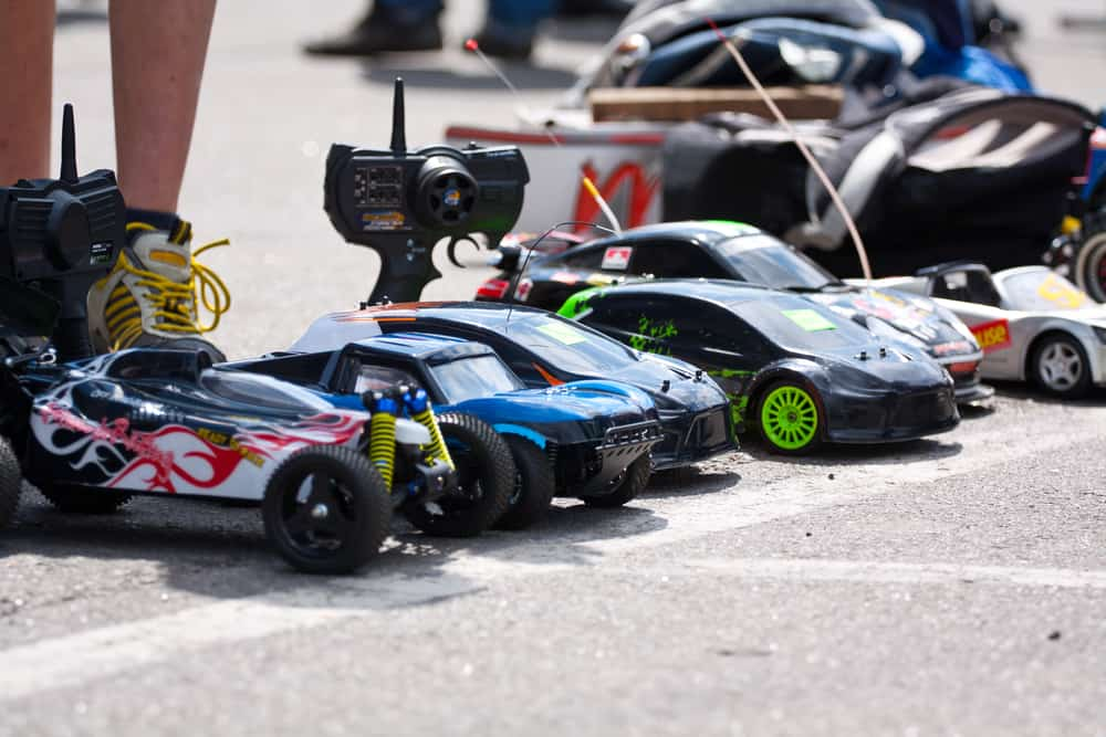 A close look at a row of remote-controlled toy cars.