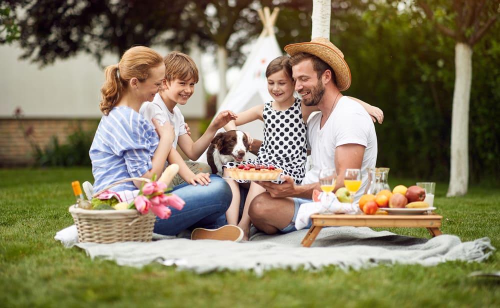 A happy family on a backyard picnic.