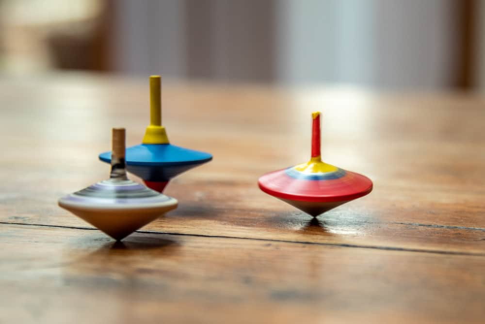 Colorful wooden spinning tops.