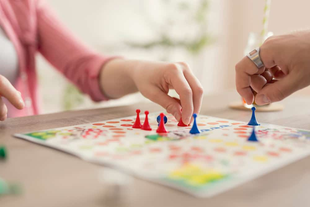 A couple playing a board game.