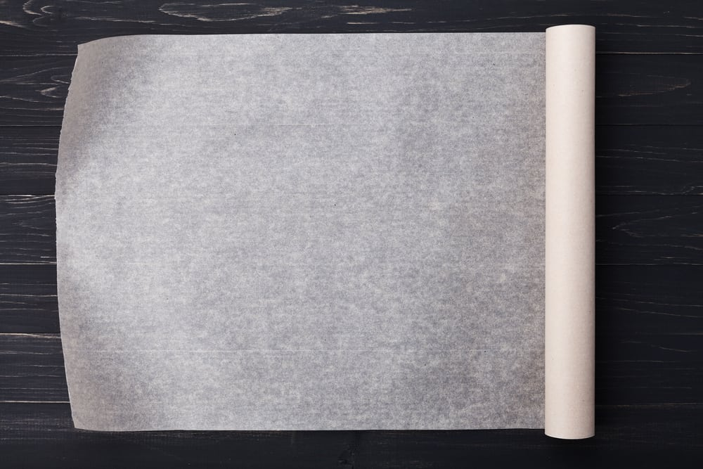 A roll of vellum paper for baking.
