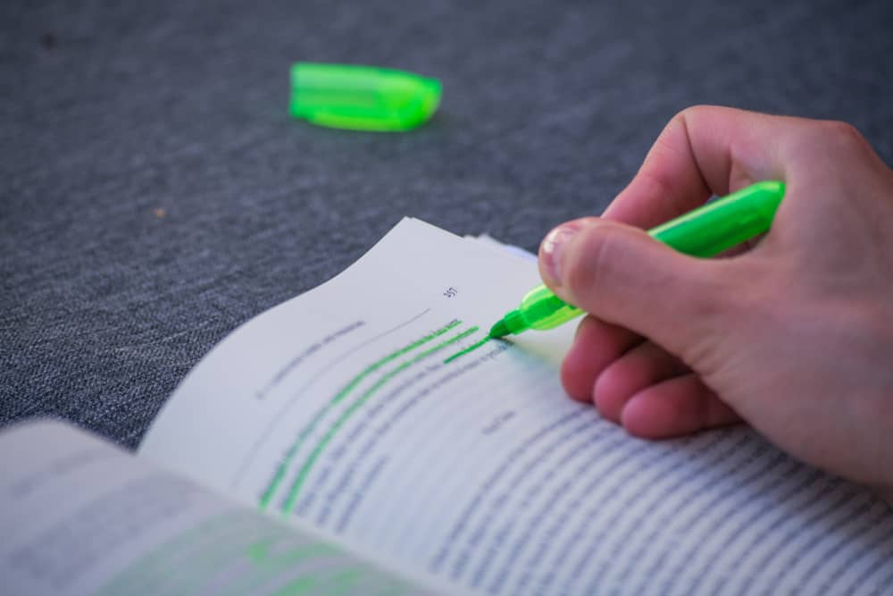 A book highlighted with green marker.