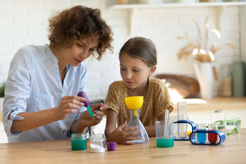 A mother and daughter doing a science experiment together.