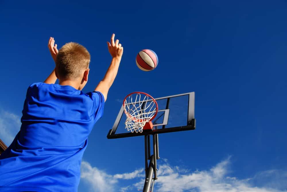 A close look at a boy playing basketball.