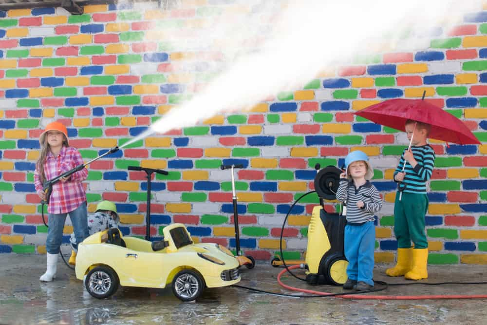 Children playing with carwash equipment and toy cars.
