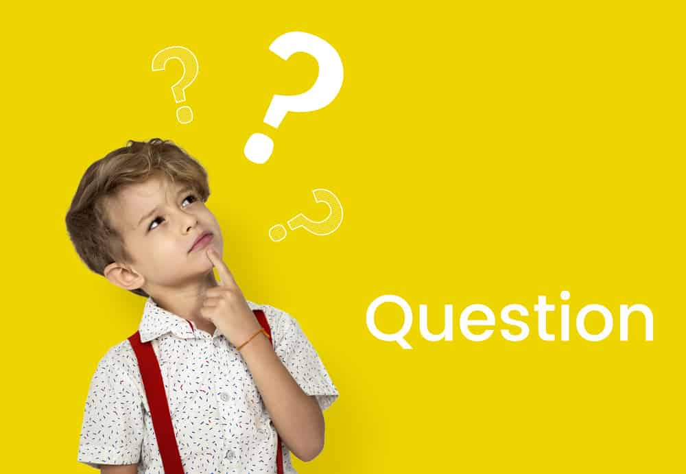 A young boy thinking of questions.