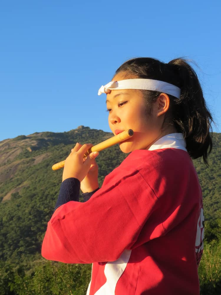 A girl playing the shinobue flute.