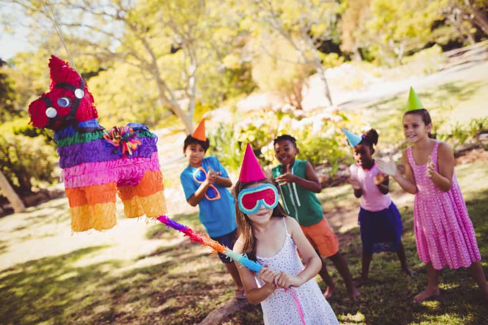 A group of kids at a piñata party.