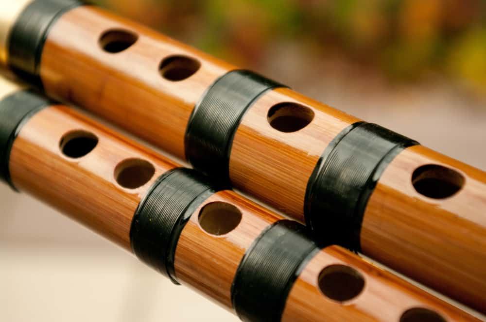This is a close look at a couple of bamboo dizi flutes.