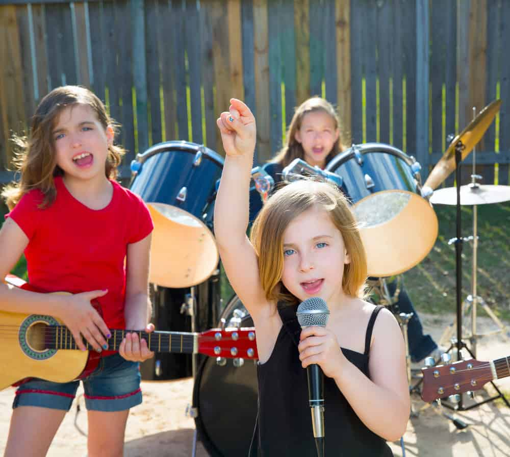 Three girls performing in a band.