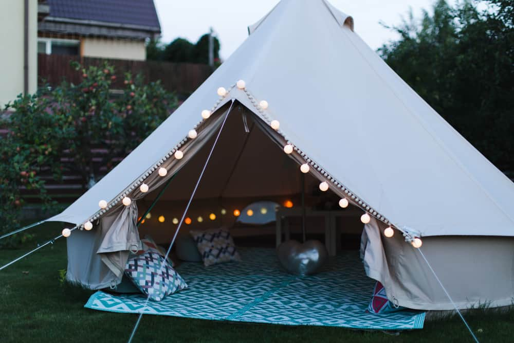 A close look at a lighted tent set up in the backyard.