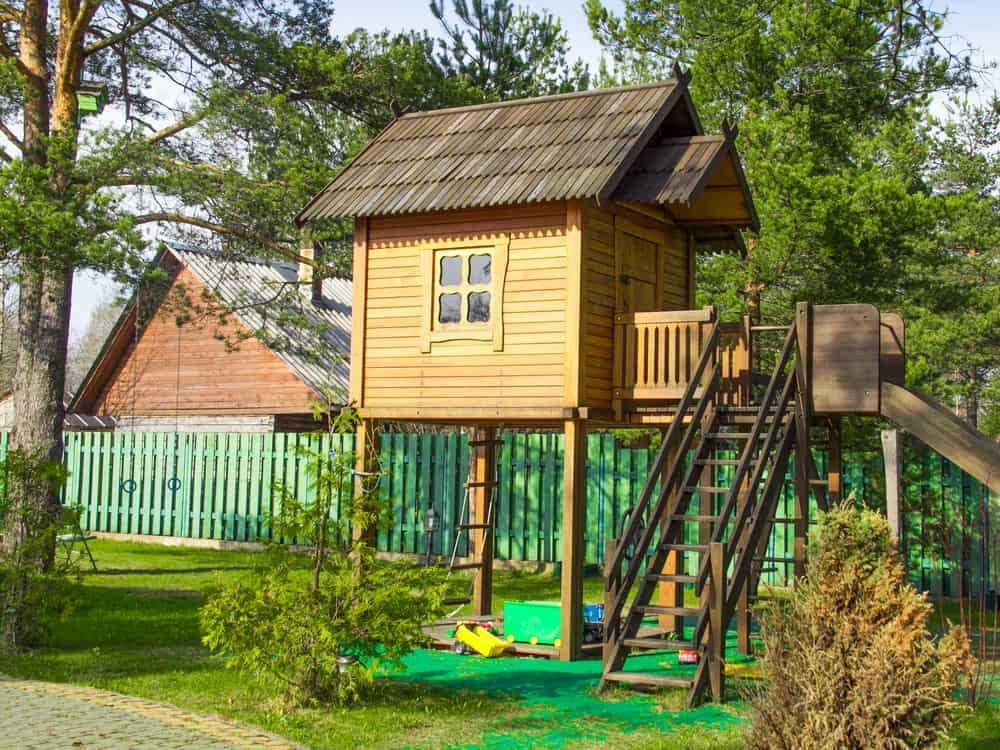 A close look at a backyard tree house set.