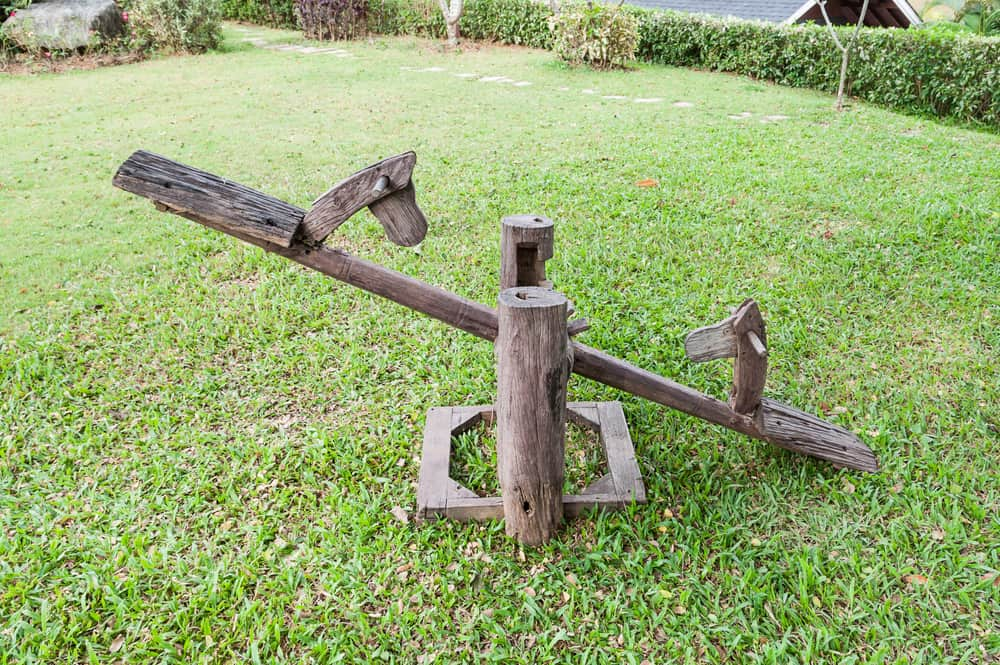 This is a rustic wooden seesaw.